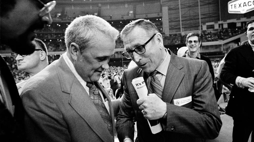 "FILE - In this March 27, 1971, file photo, Villanova University basketball coach Jack Kraft, left, congratulates UCLA coach John Wooden after Wooden's Bruins defeated Villanova, 68-62, to win the NCAA championship in Houston, Texas. Villanova officials say former head basketball coach John ""Jack"" Kraft, who led the Wildcats to 238 victories over a dozen seasons and a 1971 title game appearance, died Thursday, Aug. 28, 2014, in New Jersey. He was 93. (AP Photo/File)"