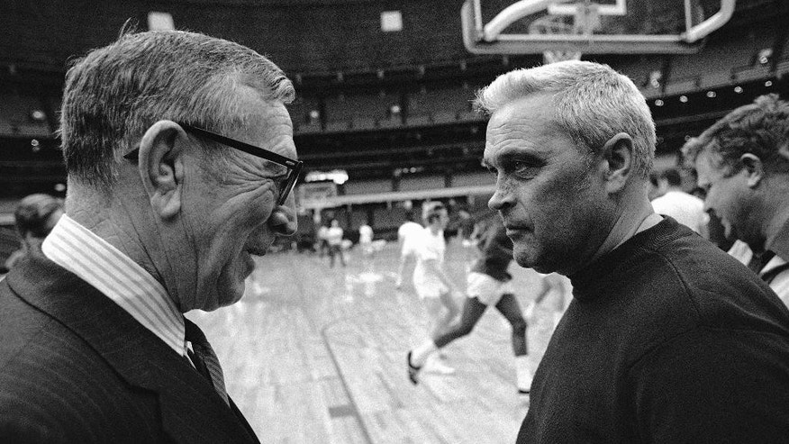 "FILE - In this March 26, 1971, file photo, coaches John Wooden of UCLA, left, and Jack Kraft of Villanova, whose basketball teams meet for the NCAA Championship exchange greetings during team workouts at the Astrodome in Houston. Villanova officials say former head basketball coach John ""Jack"" Kraft, who led the Wildcats to 238 victories over a dozen seasons and a 1971 title game appearance, died Thursday, Aug. 28, 2014, in New Jersey. He was 93. (AP Photo/File)"