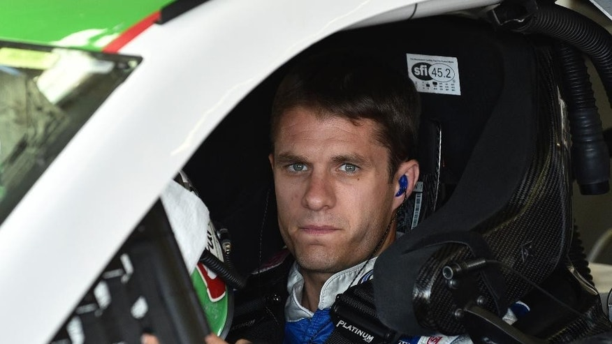NASCAR driver David Ragan waits to practice for Sunday's NASCAR auto race at Atlanta Motor Speedway in Hampton, Ga., Friday, August 29, 2014. (AP Photo/David Tulis)