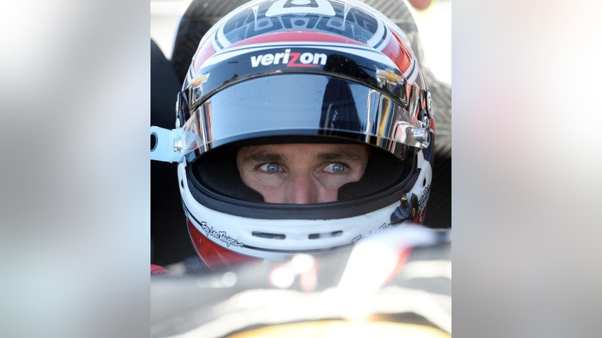 Series points leader Will Power waits in his race car in the pits for practice for Saturday's Indycar auto race Friday, Aug. 29, 2014, at Auto Club Speedway, in Fontana, Calif. (AP Photo/Will Lester)