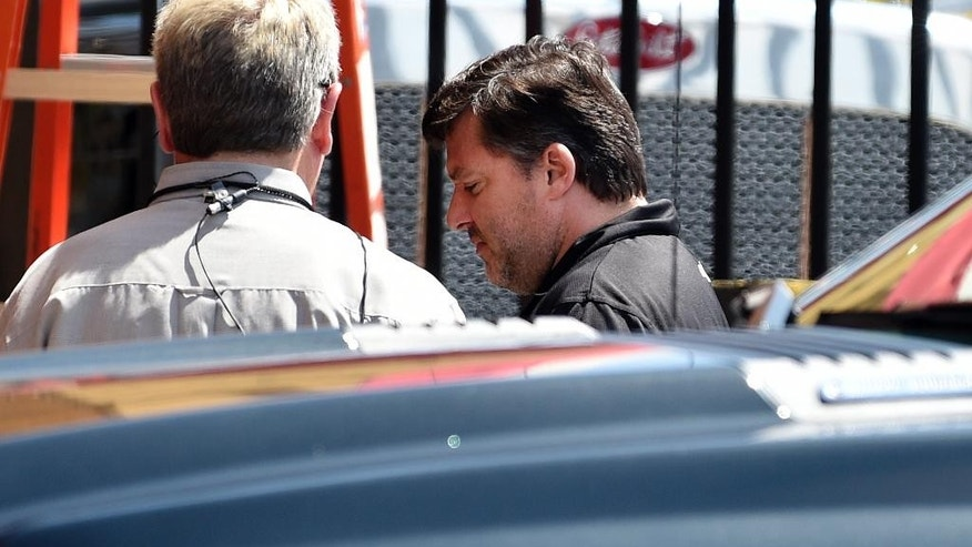 "NASCAR auto racing driver Tony Stewart, right, arrives for a news conference at Atlanta Motor Speedway in Hampton, Ga., Friday, Aug. 29, 2014. Stewart says the death of Kevin Ward Jr. will ""affect my life forever"" as he returned to the track for the first time since his car struck and killed the fellow driver during a sprint-car race in New York. (AP Photo/David Tulis)"