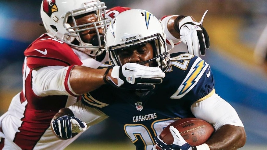 Arizona Cardinals linebacker Desmond Bishop grabs the face mask of San Diego Chargers running back Marion Grice during the first half of an NFL preseason football game Thursday, Aug. 28, 2014, in San Diego. (AP Photo/Lenny Ignelzi)
