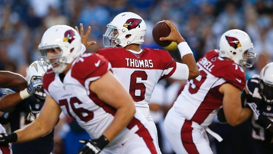 Arizona Cardinals quarterback Logan Thomas throws a pass against the San Diego Chargers during the first half of an NFL preseason football game Thursday, Aug. 28, 2014, in San Diego. (AP Photo/Lenny Ignelzi)