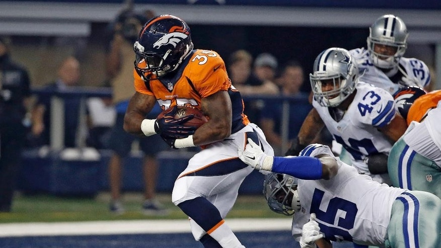Denver Broncos running back Kapri Bibbs (35) fights his way past Dallas Cowboys defensive end Caesar Rayford (95) into the end zone for a touchdown in the second half of a NFL preseason football game, Thursday, Aug. 28. 2014, in Arlington, Texas. (AP Photo/Brandon Wade)