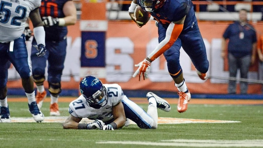 Syracuse Terrel Hunt, right, goes flying after being tripped by Villanova's Malik Reaves during an NCAA college football game at the Carrier Dome, Friday, Aug. 29, 2014 in Syracuse, N.Y. (AP Photo/Heather Ainsworth)