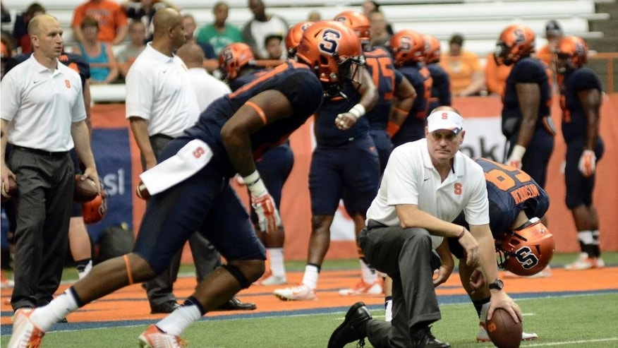 Syracuse Orange head coach Scott Shafer watches his team warm up before their game against Villanova at the Carrier Dome in Syracuse, N.Y., Friday, Aug. 29, 2014. (AP Photo/Heather Ainsworth)