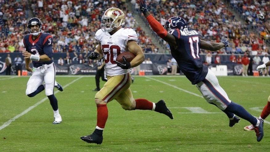 San Francisco 49ers' Chris Borland (50) runs an interception back for a touchdown past Houston Texans' Uzoma Nwachukwu (17) during the third quarter of an NFL football preseason game Thursday, Aug. 28, 2014, in Houston. (AP Photo/Patric Schneider)