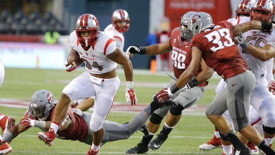 Rutgers running back Paul James (34) runs the ball as Washington State linebacker Darryl Monroe misses a tackle at lower left in the first half of an NCAA college football game, Thursday, Aug. 28, 2014, in Seattle. (AP Photo/Ted S. Warren)