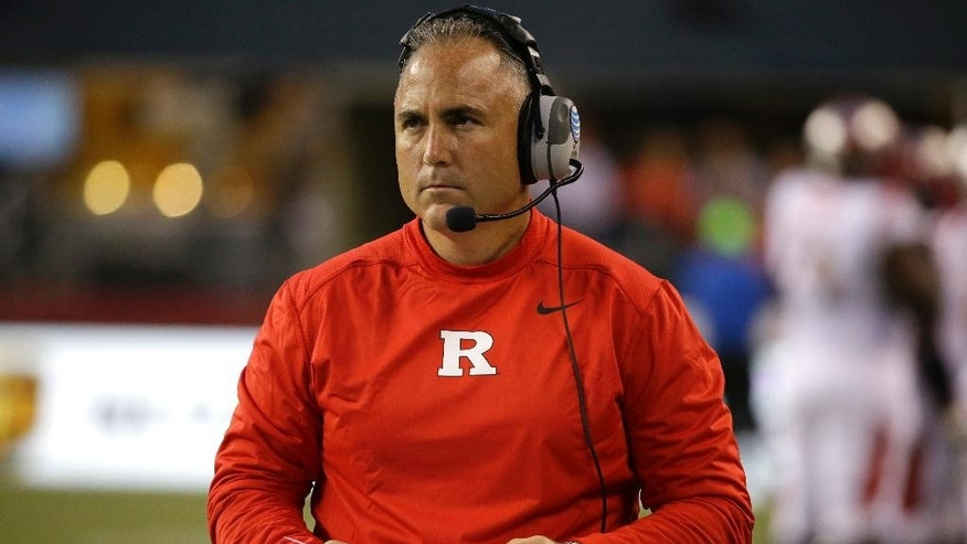 Rutgers coach Kyle Flood looks toward the scoreboard in the first half of an NCAA college football game against Washington State, Thursday, Aug. 28, 2014, in Seattle. (AP Photo/Ted S. Warren)