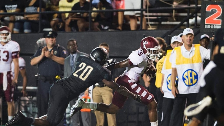 Temple's Jalen Fitzpatrick stiff-arm's Vanderbilt's Oren Burks on his way to a touchdown during the second quarter of an NCAA college football game Thursday, Aug. 28, 2014, in Nashville, Tenn. (AP Photo/Brian Powers)