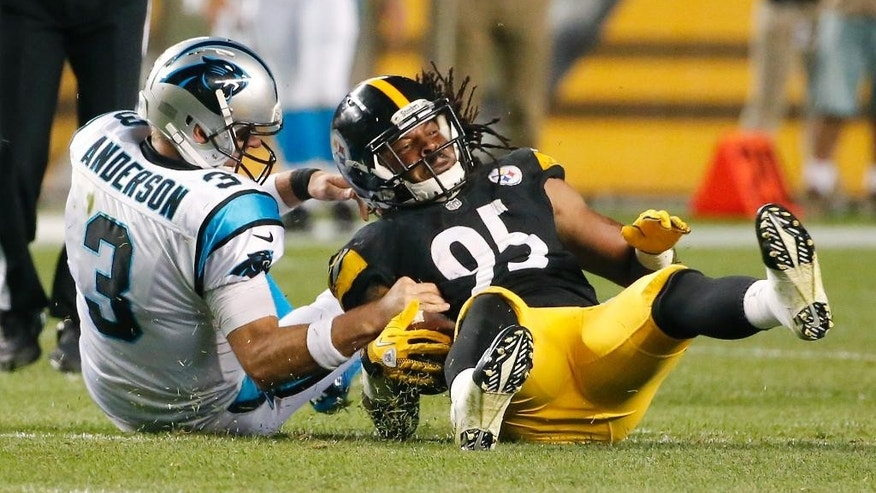 Pittsburgh Steelers outside linebacker Jarvis Jones (95) recovers a fumble by Carolina Panthers quarterback Derek Anderson (3) in the second quarter of a NFL preseason football game on Thursday, Aug. 28, 2014 in Pittsburgh. (AP Photo/Gene Puskar)