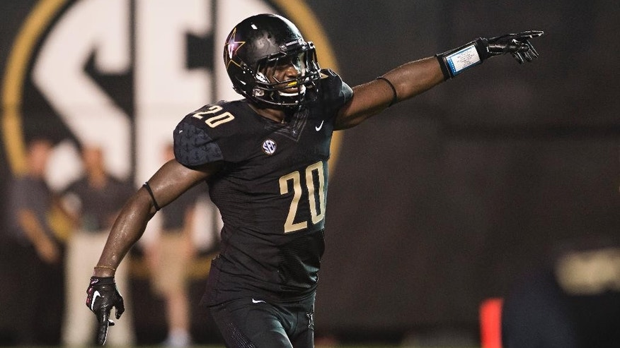 Vanderbilt's Oren Burks celebrates after recovering a fumbled Temple snap in the end zone in the second quarter of an NCAA college football game Thursday, Aug. 28, 2014, in Nashville, Tenn. (AP Photo/Brian Powers)
