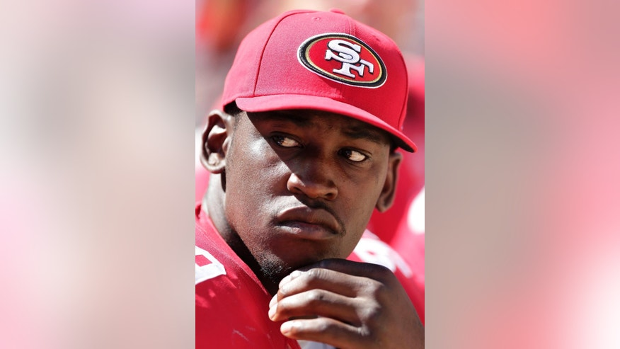FILE - In this Aug. 24, 2014, file photo, San Francisco 49ers linebacker Aldon Smith (99) sits on the sideline during the second half of an NFL preseason football game against the San Diego Chargers in Santa Clara, Calif. Aldon Smith has been suspended for nine games by the NFL after a series of off-field legal issues. A statement Friday, Aug. 29, 2014, from the league said Smith had violated the NFL's substance abuse and personal conduct policies. (AP Photo/Marcio Jose Sanchez, File)