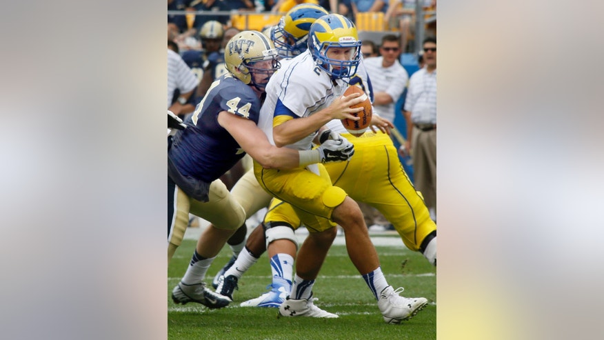 Pittsburgh defensive lineman David Durham (44) sacks Delaware quarterback Trent Hurley (2) in the first quarter of an NCAA college football game on Saturday, Aug. 30, 2014, in Pittsburgh. (AP Photo/Keith Srakocic)