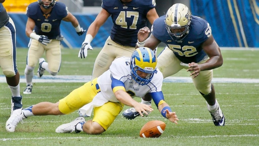 Delaware quarterback Trent Hurley (2) recovers a snap fumble in front of  Pittsburgh's  Shakir Soto (52) in the first quarter of an NCAA college football game on Saturday, Aug. 30, 2014, in Pittsburgh. (AP Photo/Keith Srakocic)