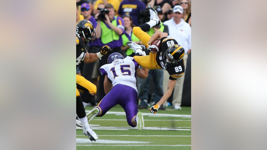 Iowa wide receiver Matt Vandeberg is upended by Northern Iowa defensive back Tate Omli on a kickoff return during the first half of an NCAA college football game Saturday, Aug. 30, 2014, in Iowa City, Iowa. (AP Photo/Justin Hayworth)