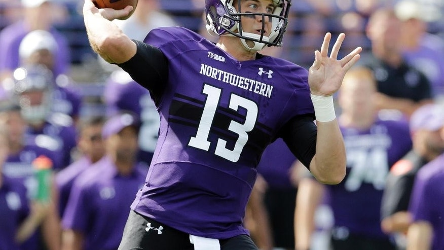 Northwestern quarterback Trevor Siemian (13) looks to a pass during the first half of an NCAA college football game against California in Evanston, Ill., Saturday, Aug. 30, 2014. (AP Photo/Nam Y. Huh)