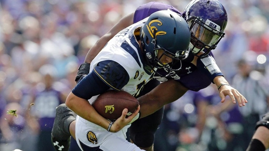 Northwestern linebacker Chi Chi Ariguzo, right, sacks California quarterback Jared Goff (16) during the first half of an NCAA college football game in Evanston, Ill., Saturday, Aug. 30, 2014. (AP Photo/Nam Y. Huh)