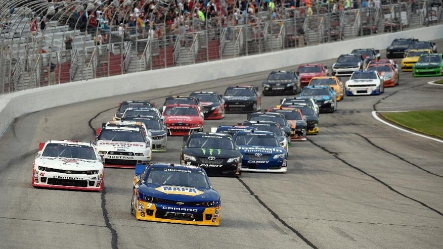 Nationwide Series driver Chase Elliott (9) leads a pack of cars to start the NASCAR Nationwide Cup Series Great Clips 300 auto race at Atlanta Motor Speedway, Saturday, Aug. 30, 2014 in Hampton, Ga. (AP Photo/David Tulis)