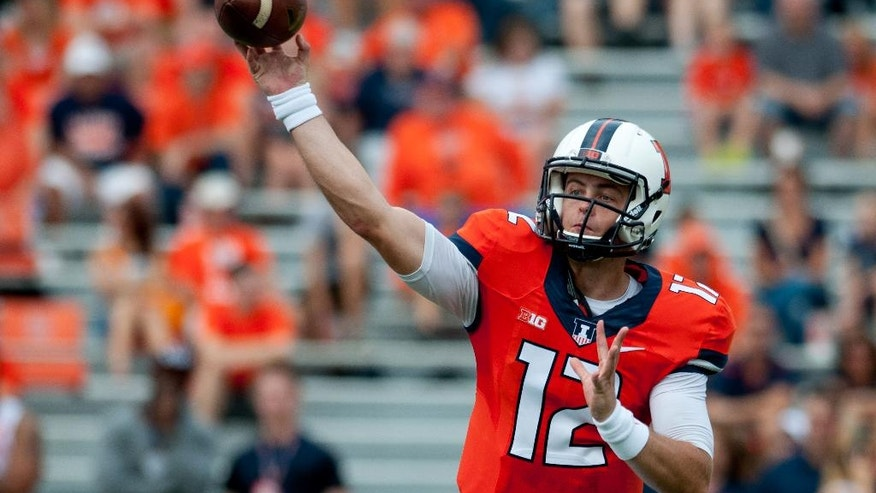 Illinois quarterback Wes Lunt (12) throws the ball during the second quarter of an NCAA college football game against Youngstown State, Saturday, Aug. 30, 2014, at Memorial Stadium in Champaign, Ill. (AP Photo/Bradley Leeb)
