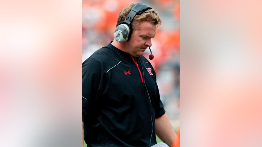Youngstown State head coach Eric Wolford looks down during the second quarter of an NCAA college football game against Illinois, Saturday, Aug. 30, 2014, at Memorial Stadium in Champaign, Ill. (AP Photo/Bradley Leeb)