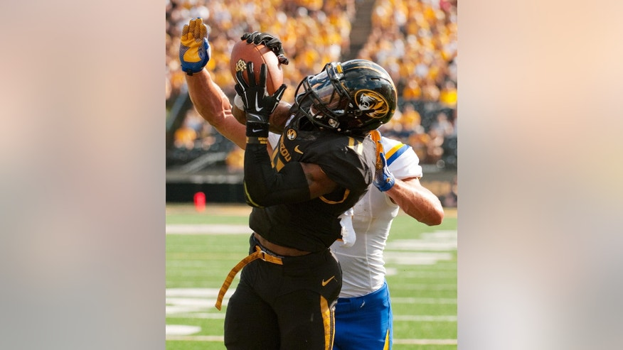 Missouri's Aarion Penton, left, intercepts the ball in front of South Dakota State's Jason Schneider in the end zone during the third quarter of an NCAA college football game Saturday, Aug. 30, 2014, in Columbia, Mo. (AP Photo/L.G. Patterson)