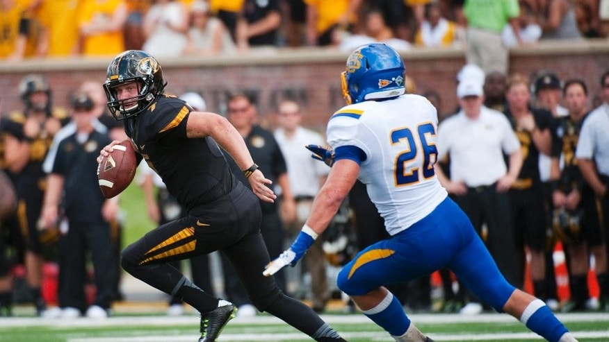 Missouri quarterback Maty Mauk, left, runs from South Dakota State's Drew Kreutzfeldt as he looks to pass during the first quarter of an NCAA college football game, Saturday, Aug. 30, 2014, in Columbia, Mo. (AP Photo/L.G. Patterson)