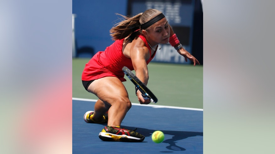 Aleksandra Krunic, of Serbia, returns a shot to Petra Kvitova, of the Czech Republic, during the third round of the 2014 U.S. Open tennis tournament, Saturday, Aug. 30, 2014, in New York. (AP Photo/Kathy Willens)