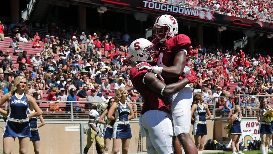 Stanford wide receiver Ty Montgomery, left, celebrates his touchdown reception with teammate Francis Owusu during the first half of an NCAA college football game against UC Davis on Saturday, Aug. 30, 2014, in Stanford , Calif. (AP Photo/Marcio Jose Sanchez)