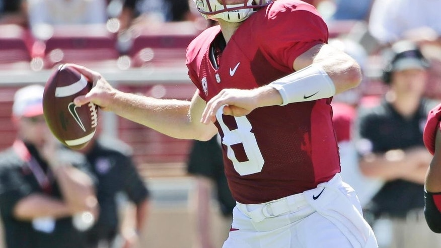 Stanford quarterback Kevin Hogan throws against UC Davis during the first half of an NCAA college football game on Saturday, Aug. 30, 2014, in Stanford, Calif. (AP Photo/Marcio Jose Sanchez)