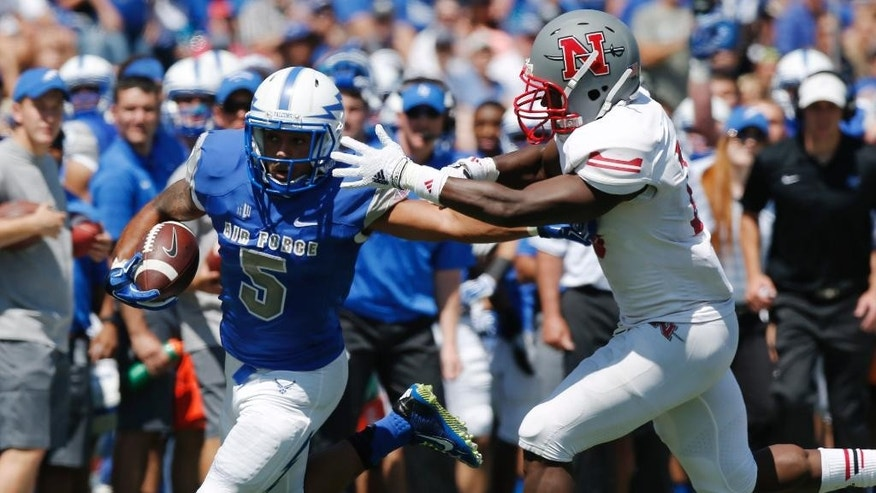 Air Force running back Devin Rushing, left, runs for a long gain as Nicholls State defensive back B.T. Sanders defends in the second quarter of an NCAA college football game at Air Force Academy, Colo., on Saturday, Aug. 30, 2014. (AP Photo/David Zalubowski)