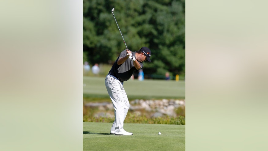 Ryan Palmer hits his third shot on the second hole during the first round of the Deutsche Bank Championship golf tournament in Norton, Mass., Friday, Aug. 29, 2014. (AP Photo/Stew Milne)