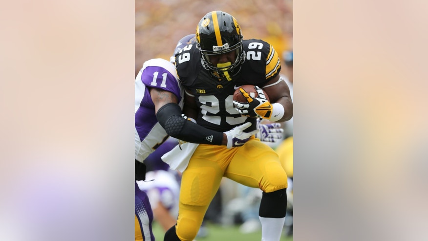 Iowa running back LeShun Daniels Jr. (29) breaks the tackle of Northern Iowa defensive back Ray Mitchell (11) to score a touchdown during the first half of an NCAA college football game, Saturday, Aug. 30, 2014, in Iowa City, Iowa. (AP Photo/Justin Hayworth)