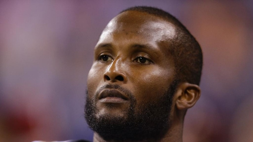 FILE - In this Aug. 23, 2014, file photo, New Orleans Saints cornerback Champ Bailey looks on before an NFL preseason football game against the Indianapolis Colts in Indianapolis. After playing at an elite level for more than a decade, Bailey enters the final game of the preseason with little certainty about what kind of role he might fill on the Saints' secondary. (AP Photo/Michael Conroy, File)