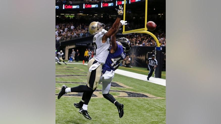 Baltimore Ravens defensive back Dominique Franks (42) breaks up a pass in the end zone intended for New Orleans Saints wide receiver Robert Meachem (17) during the first half of an NFL preseason football game in New Orleans, Thursday, Aug. 28, 2014. (AP Photo/Bill Haber)