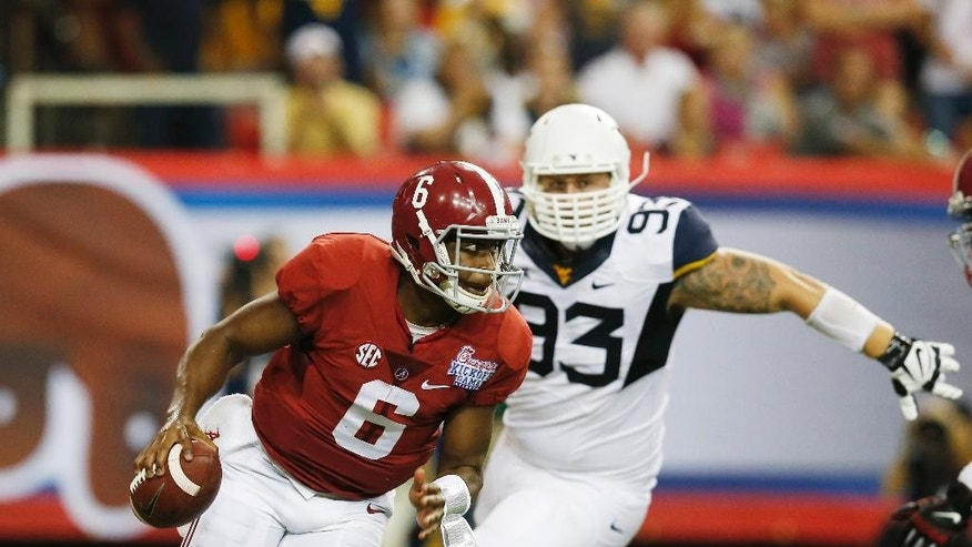 Alabama quarterback Blake Sims (6) scrambles away from West Virginia defensive lineman Kyle Rose (93) during the first half of an NCAA college football game Saturday, Aug. 30, 2014, in Atlanta.  (AP Photo/Bryn Anderson)