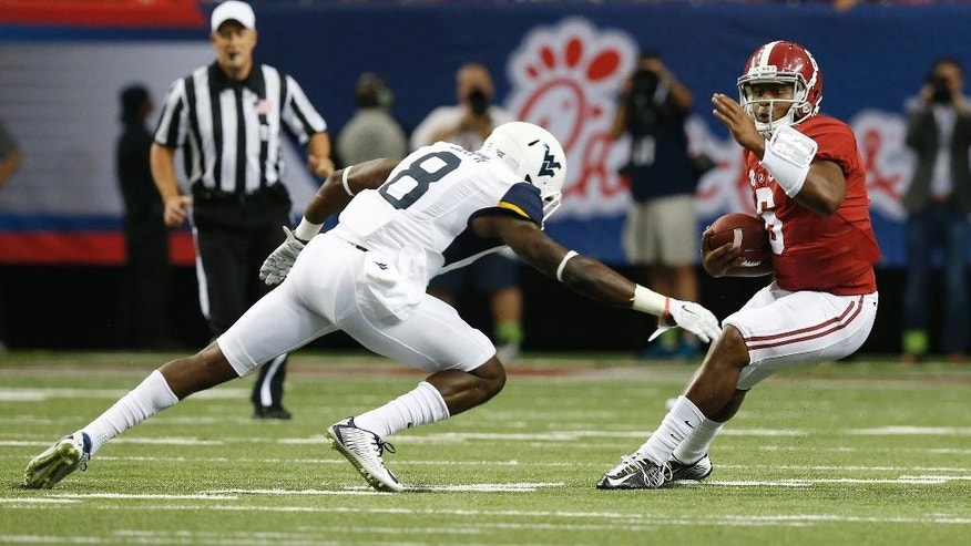 Alabama quarterback Blake Sims (6) tries to get away from West Virginia safety Karl Joseph (8) in the first half of an NCAA college football game Saturday, Aug. 30, 2014, in Atlanta.  (AP Photo/Brynn Anderson)