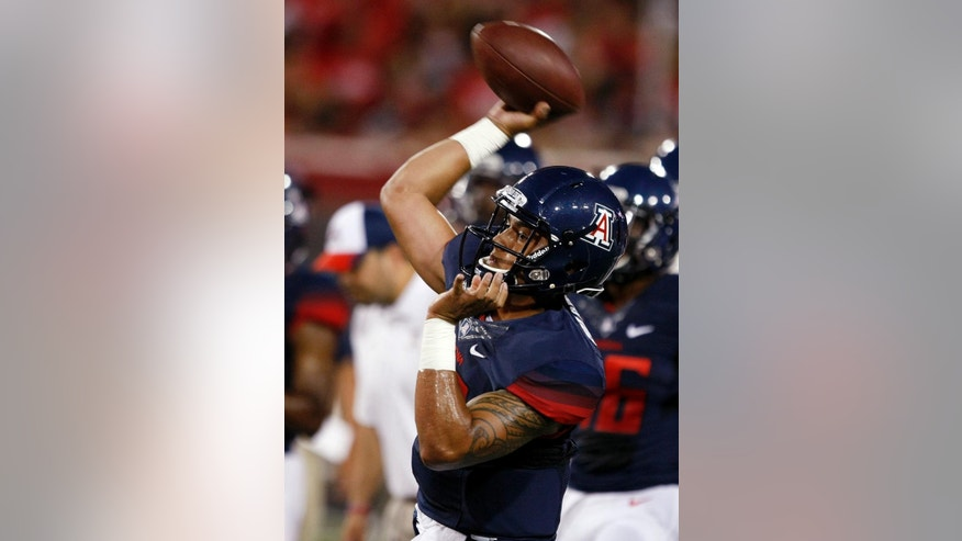 Arizona quarterback Anu Solomon warms up for an NCAA college football game against UNLV, Friday, Aug. 29, 2014, in Tucson, Ariz. (AP Photo/Rick Scuteri)