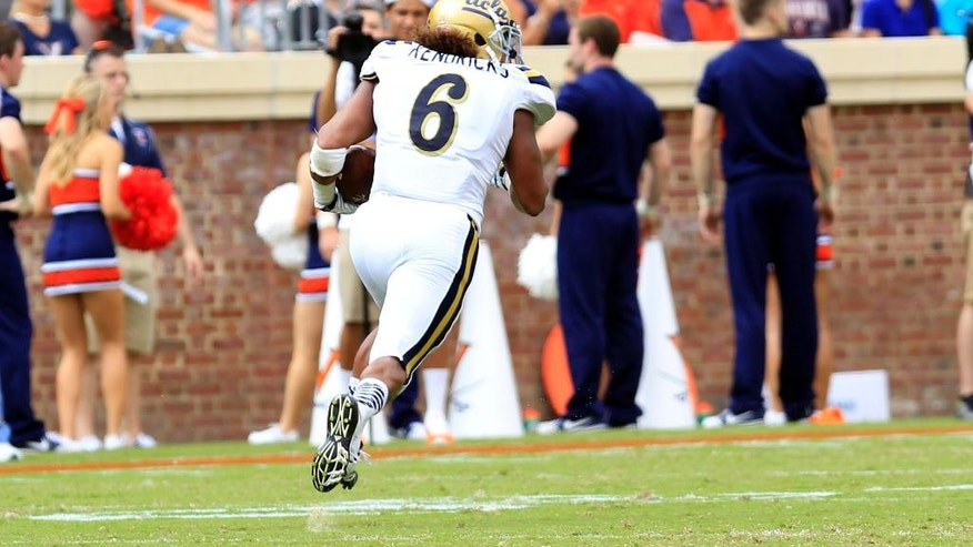 UCLA linebacker Eric Kendricks (6) returns an interception for a touchdown during the first half of an NCAA college football game against Virginia at Scott Stadium, Saturday, Aug. 30, 2014, in Charlottesville, Va. (AP Photo/Andrew Shurtleff)