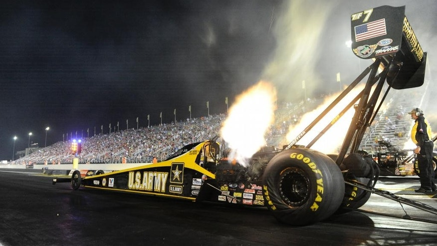 In this photo submitted by the NHRA, Top Fuel racer Tony Schumacher is the qualifying leader after the first round of qualifying for the Chevrolet Performance U.S. Nationals at Lucas Oil Raceway at Indianapolis Friday Aug. 29, 2014. Schumacher has nine career Top Fuel wins, the most in the category, at the event. Top Fuel qualifying for the NHRA Mello Yello Drag Racing Series event resumes on Saturday. (AP Photo/NHRA, Marc Gewertz)