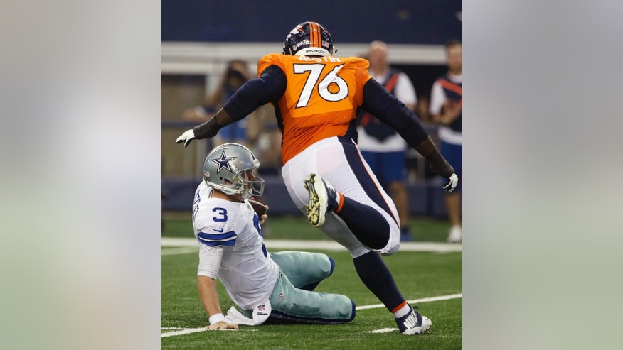 Dallas Cowboys quarterback Brandon Weeden (3) slides on the ground under pressure from Denver Broncos defensive tackle Marvin Austin (76) after Weeden gained yardage on a short run from the line of scrimmage in the first half of a NFL preseason football game, Thursday, Aug. 28. 2014, in Arlington, Texas. (AP Photo/Tony Gutierrez)