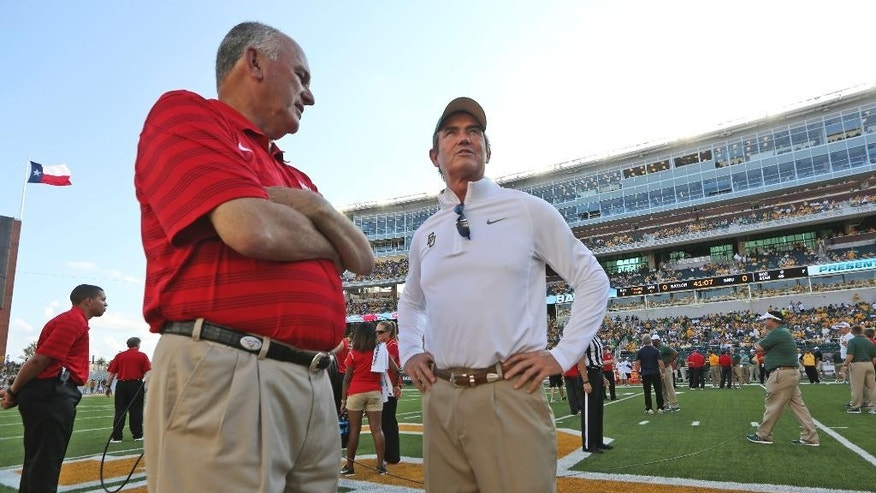 Baylor head coach Art Briles, right, and SMU head coach June Jones visit on the field before an NCAA college football game Sunday, Aug. 31, 2014, in Waco, Texas. (AP Photo/LM Otero)
