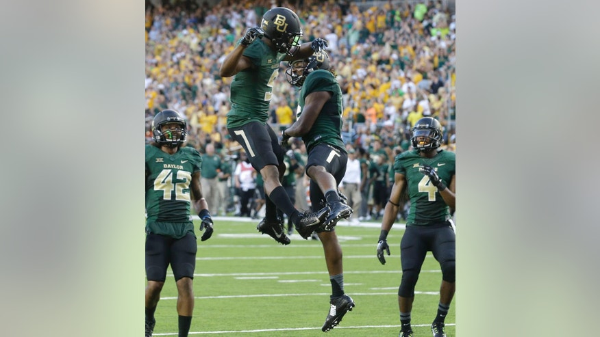 Baylor wide receiver KD Cannon (9) celebrates his touchdown catch with teammate Davion Hall (16) as Levi Norwood (42) and Jay Lee (4) look on during the first half of an NCAA college football game against SMU Sunday, Aug. 31, 2014, in Waco, Texas. (AP Photo/LM Otero)