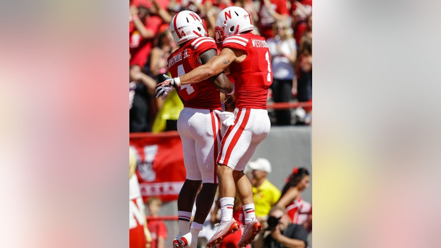 Nebraska wide receiver Jordan Westerkamp (1) celebrates his touchdown from a pass by Nebraska quarterback Tommy Armstrong Jr. (4), in the first half of an NCAA college football game against Florida Atlantic in Lincoln, Neb., Saturday, Aug. 30, 2014. (AP Photo/Nati Harnik)