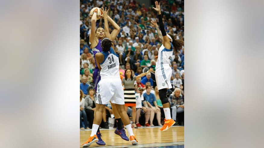Phoenix Mercury center Brittney Griner, top left, lines up a shot against Minnesota Lynx forward Damiris Dantas (34) and guard Seimone Augustus, right, during the first half of Game 2 of the WNBA basketball Western Conference finals, Sunday, Aug. 31, 2014, in Minneapolis. (AP Photo/Stacy Bengs)