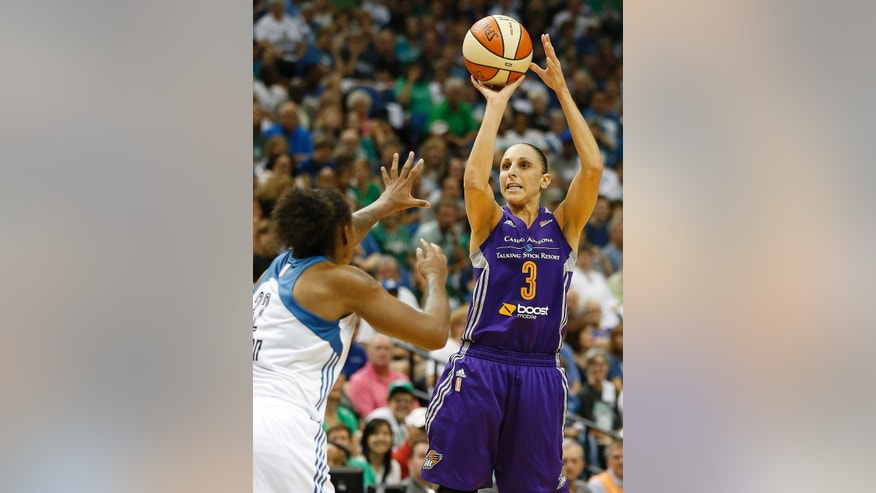 Phoenix Mercury guard Diana Taurasi (3) shoots against Minnesota Lynx forward Rebekkah Brunson during the first half of Game 2 of the WNBA basketball Western Conference finals, Sunday, Aug. 31, 2014, in Minneapolis. (AP Photo/Stacy Bengs)