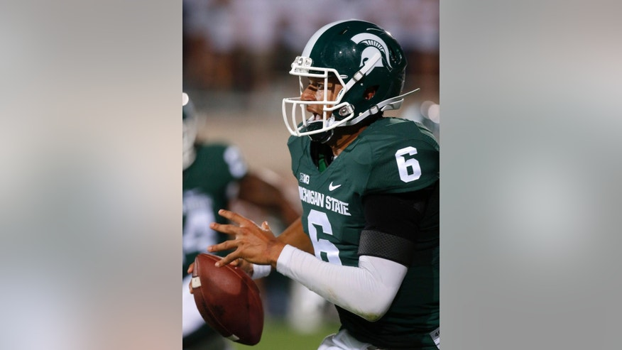 Michigan State quarterback Damion Terry scrambles against Jacksonville State during the fourth quarter of an NCAA college football game, Friday, Aug. 29, 2014, in East Lansing, Mich. Michigan State won 45-7. (AP Photo/Al Goldis)