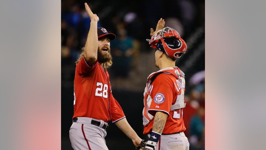 Washington Nationals right fielder Jayson Werth, left, greets catcher Jose Lobaton after the Nationals defeated the Seattle Mariners 3-1 in a baseball game, Saturday, Aug. 30, 2014, in Seattle. (AP Photo/Ted S. Warren)