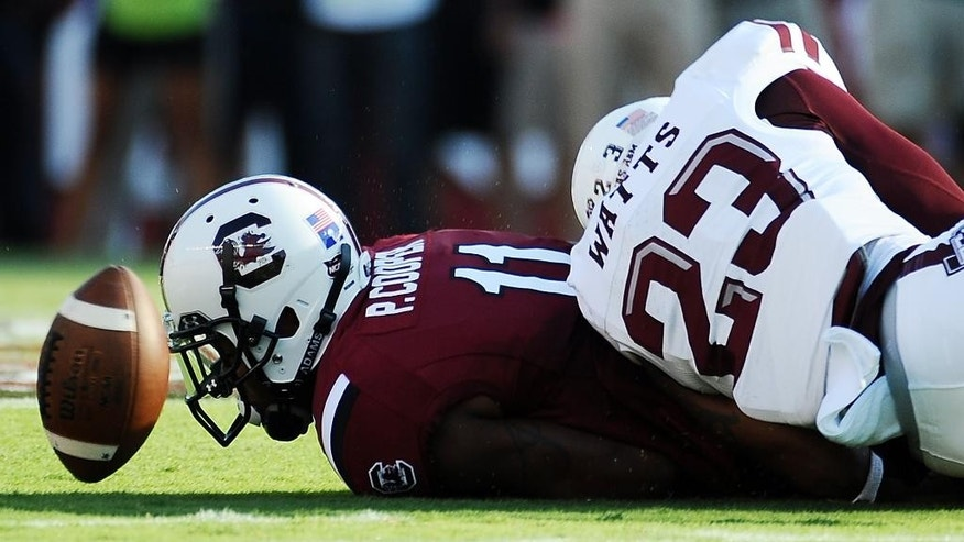 South Carolina wide receiver Pharoh Cooper (11) drops a pass as Texas A&M defensive back Armani Watts (23) defends during the first half of an NCAA college football game on Thursday, Aug. 28, 2014, in Columbia, S.C. Texas A&M won 52-28. (AP Photo/Rainier Ehrhardt)