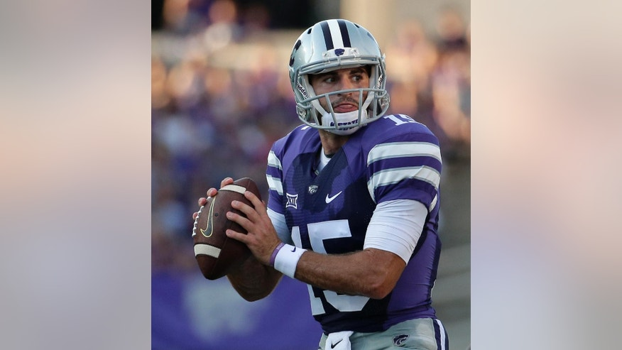 Kansas State quarterback Jake Waters (15) looks for a receiver during the first half of an NCAA college football game against the Stephen F. Austin Saturday, Aug. 30, 2014, in Manhattan, Kan. (AP Photo/Charlie Riedel)